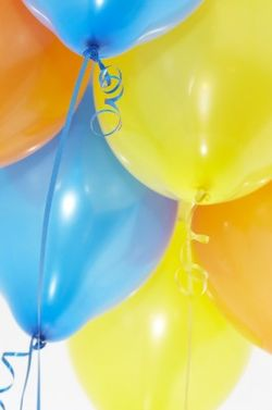 Blue and yellow balloons with streamers