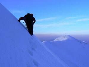 Mountain climber on snowy cap