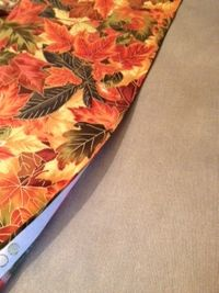 The bonded edge of fabric on ironing board
