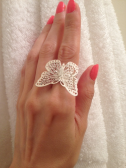 Luci Weston's hand wearing Silver Old Navy Butterfly Ring