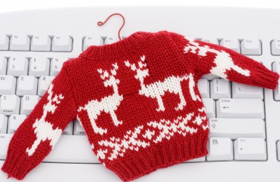 Shrunken red sweater on keyboard