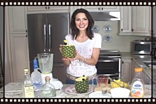 Luci Weston showing frozen Pineapple drink in pineapple shell