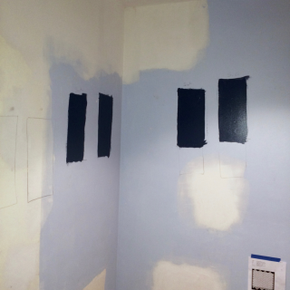 Blue paint swatches on the  bathroom wall