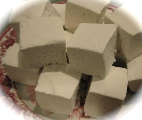 Homemade marshmallows Vanilla marshmallows on red plate