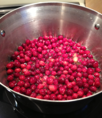 Cranberries in high walled pot cooking