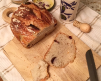 Olive bread sliced on a cutting board