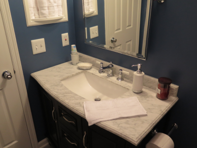 Bathroom Renovation: vanity against dark blue paint