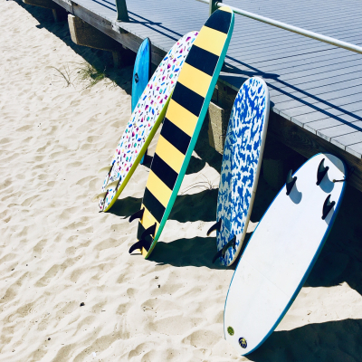 Surf boards lined up at the boardwalk